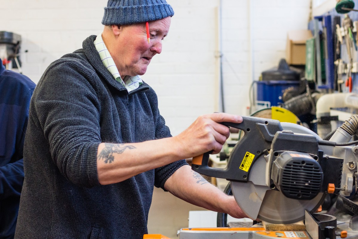 Men in Sheds Member using a saw